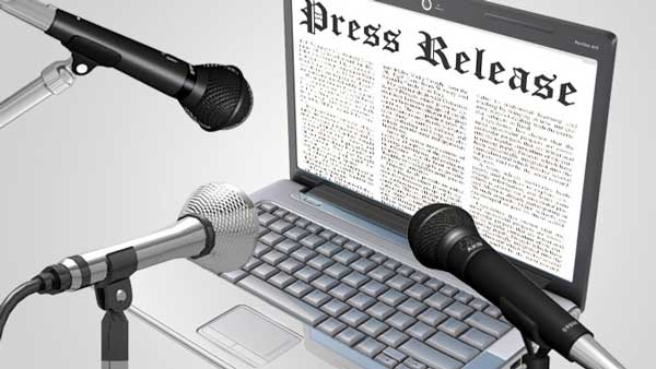 Image of Press Release Microphones and a Computer screen